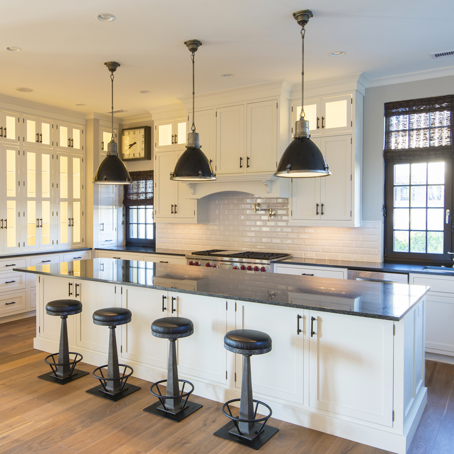 A stunning kitchen in black and white designed  by Rob Hutzler of Kingswood Homes.