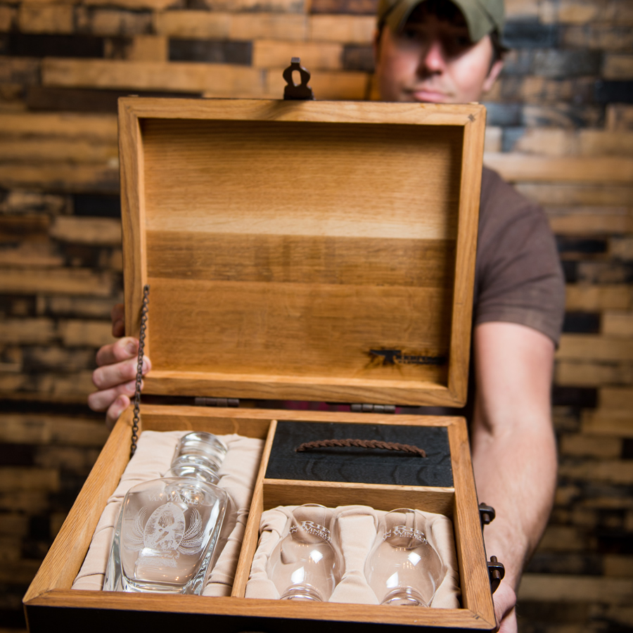 James Broyhill displaying the inside of this beautiful bourbon barrel gift box.