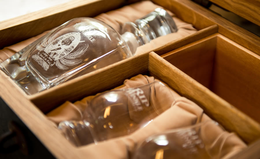 A peek at the etched glassware inside the bourbon barrel gift box.