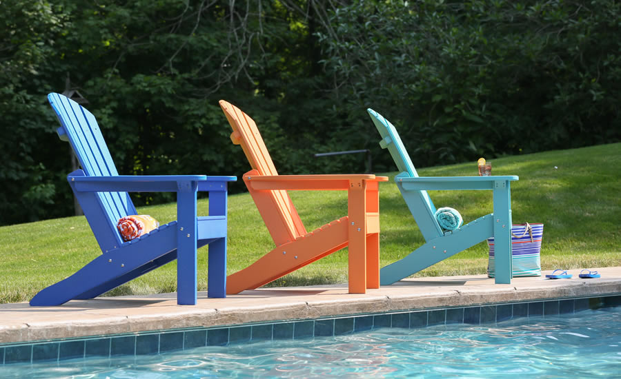 Outdoor chairs in vibrant colors from Oasis Pools Plus.