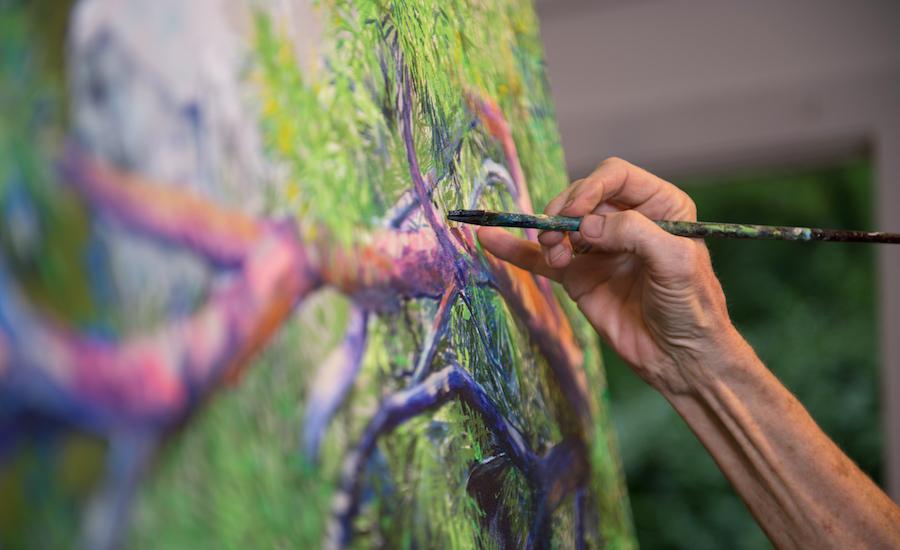 Elizabeth Bradford paints pines at Big Lost Cove Cliffs