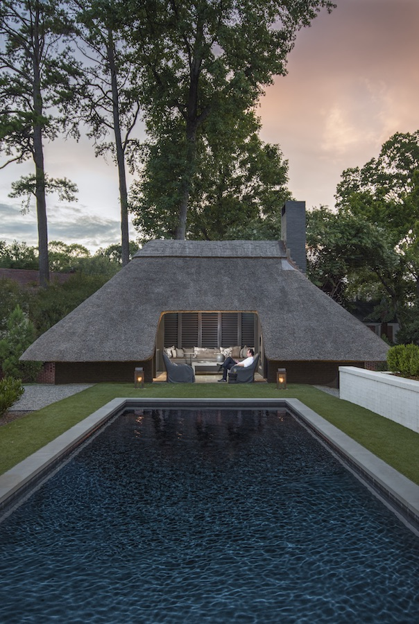 The thatched-roof pool house